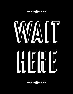 Wait Here Signage